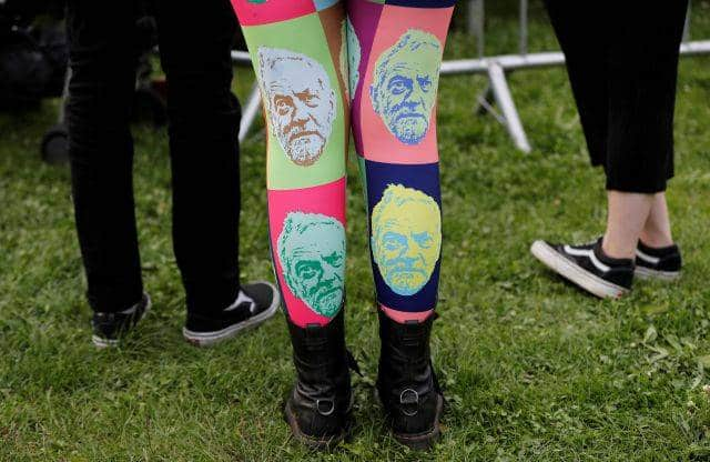 A woman wears tights showing the face of Jeremy Corbyn, leader of Britain's opposition Labour Party, at a campaign rally in Birmingham, Britain June 6, 2017. REUTERS/Darren Staples TPX IMAGES OF THE DAY - RTX39BV0
