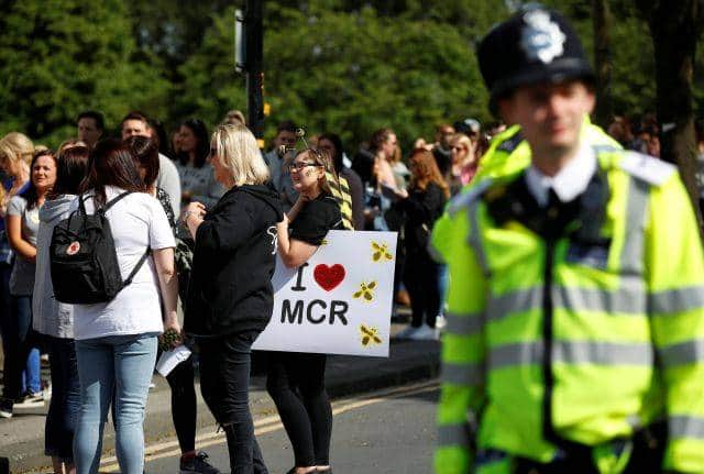A police officer stands outside the Old Trafford Cricket Ground ahead of the One Love Manchester tribute concert in Manchester, Britain, June 4, 2017. REUTERS/Phil Noble - RTX38YZZ