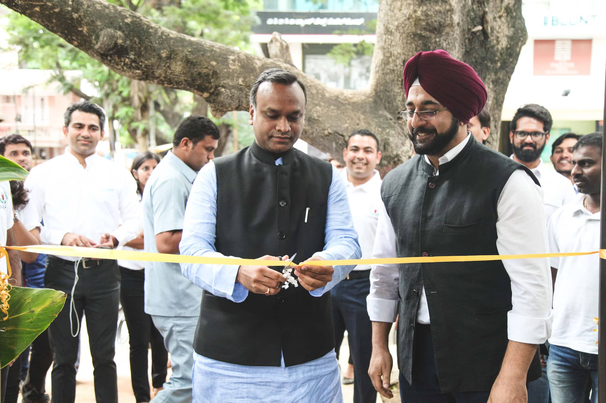 Priyank Kharge, social welfare department minister, inaugurates Chai Point's 100th store opening.