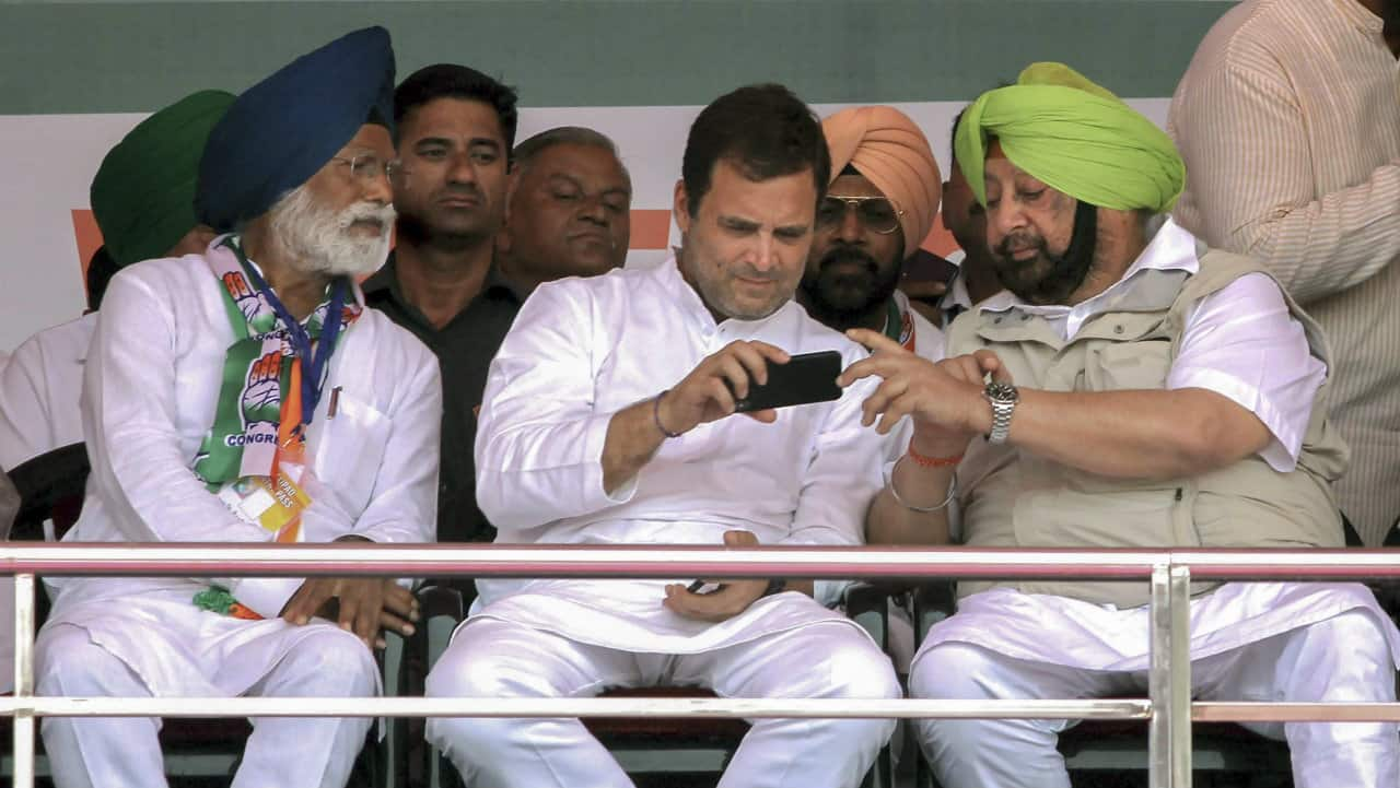 Congress leader Rahul Gandhi, Punjab Chief Minister Captain Amarinder Singh and party's candidate from Fatehgarh Sahib, Amar Singh, during a rally in Ludhiana district on May 13, 2019. (Image: PTI)