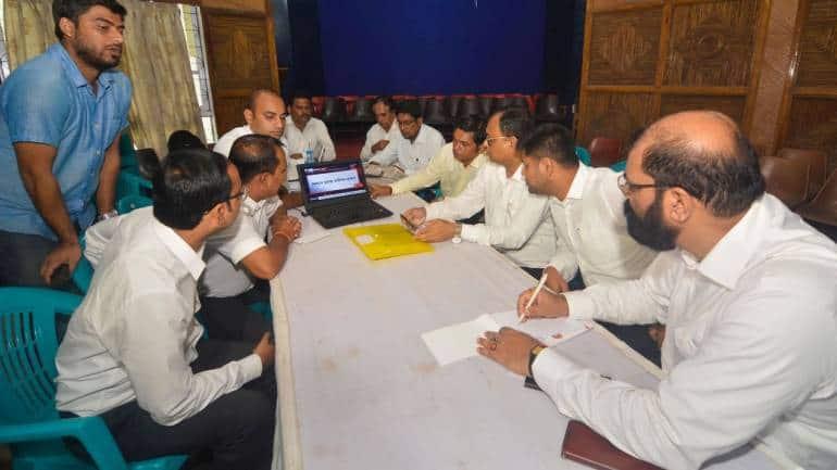 The All Assam Students' Union (AASU) Chief Adviser Samujjal Bhattacharya, President Dipanka Kumar Nath and General Secretary Lurinjyoti Gogoi watch live analysis of final National Register of Citizens (NRC) list declared on August 31, in Guwahati. (Image: PTI)