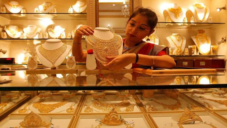 Gold rates flat at Rs 44,680 per 10 gram as dollar rebounds; silver rises Rs 83 a kg - Moneycontrol.com