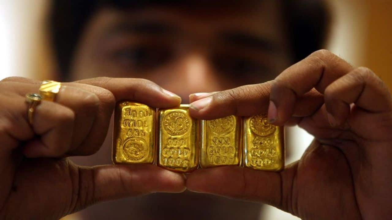Gold price dips marginally to Rs 46,929, silver gains