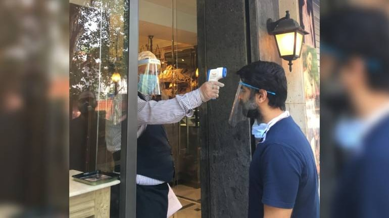 Cafes taking precautionary measures at Khan Market. Temperature checking is done. (Image: News18)