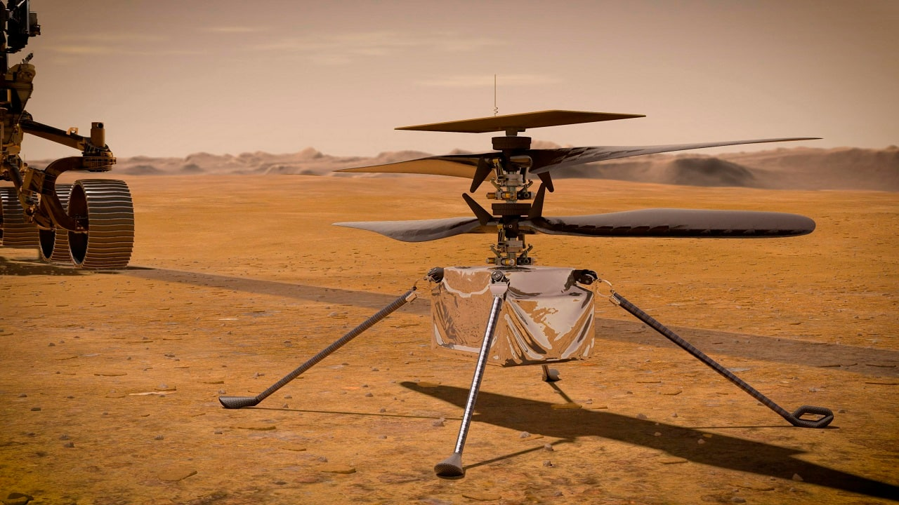 Illustration of NASA's Ingenuity Mars Helicopter on the red planet's surface near the Perseverance rover (left) (Image: NASA/JPL-Caltech via AP)