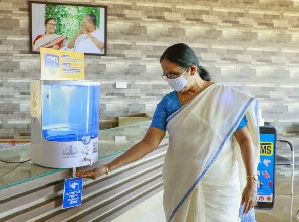 KK Shailaja launching automatic sanitizer machine in 2nd phase of break the chain campaign