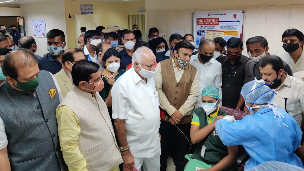 A healthcare worker is given the COVID-19 vaccine shot. Karnataka Chief Minister BS Yediyurappa is also present at the site.