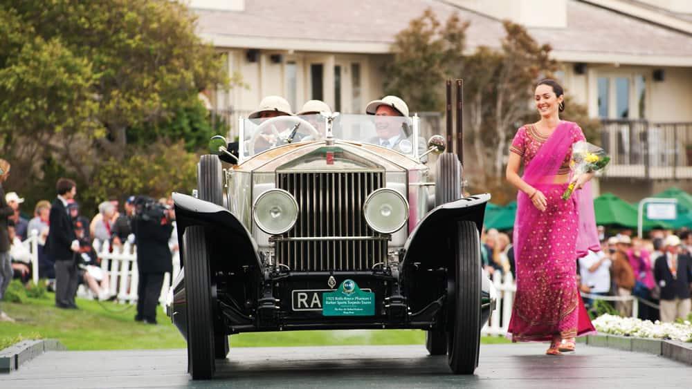 Sir Michael Kadoorie and passengers exhibit his 1925 Rolls-Royce Phantom I, built for the Maharaja of Jodhpur.