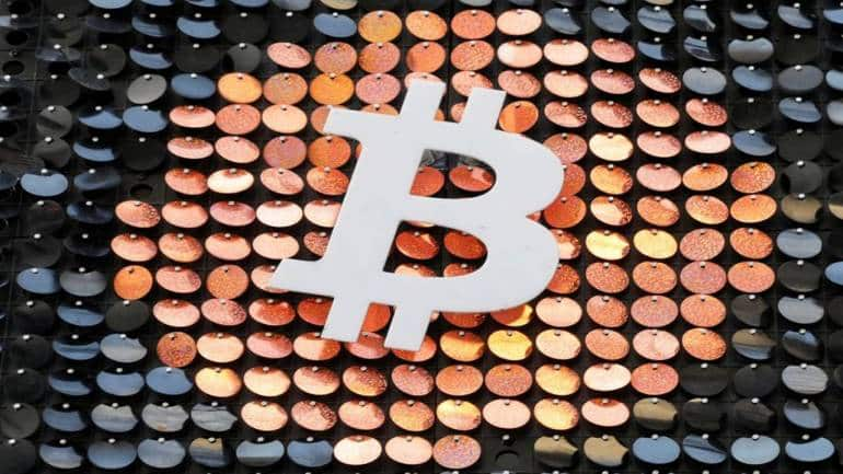 Bitcoin plunges after weekend climb to record high - Moneycontrol.com