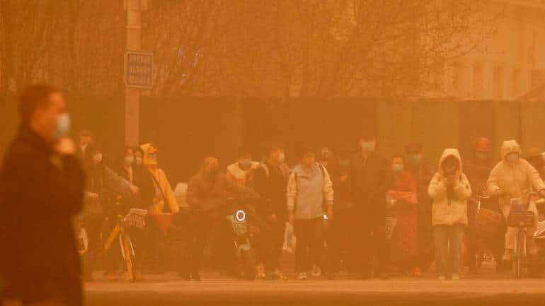 Beijing witnesses worst sandstorm in a decade, causing severe air pollution - Moneycontrol.com