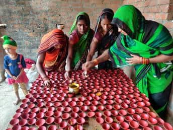One woman from each of the 98 families of Chayanpurva is now engaged in making wax diyas.