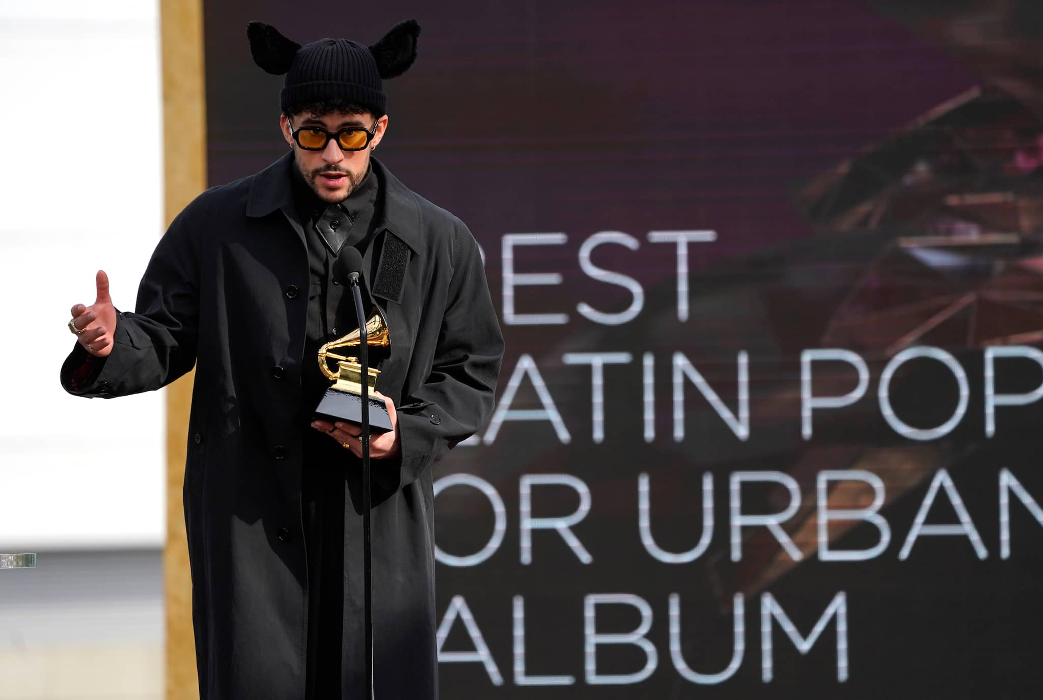 "Bad Bunny accepts the award for best latin pop or urban album for ""YHLQMDLG"" at the 63rd annual Grammy Awards at the Los Angeles Convention Center on Sunday, March 14, 2021. (AP Photo/Chris Pizzello)"