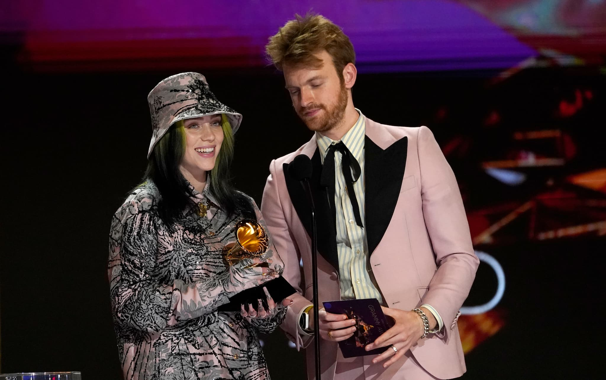 "Billie Eilish, left, and Finneas accept the award for record of the year for ""Everything I Wanted"" at the 63rd annual Grammy Awards at the Los Angeles Convention Center on Sunday, March 14, 2021. (AP Photo/Chris Pizzello)"