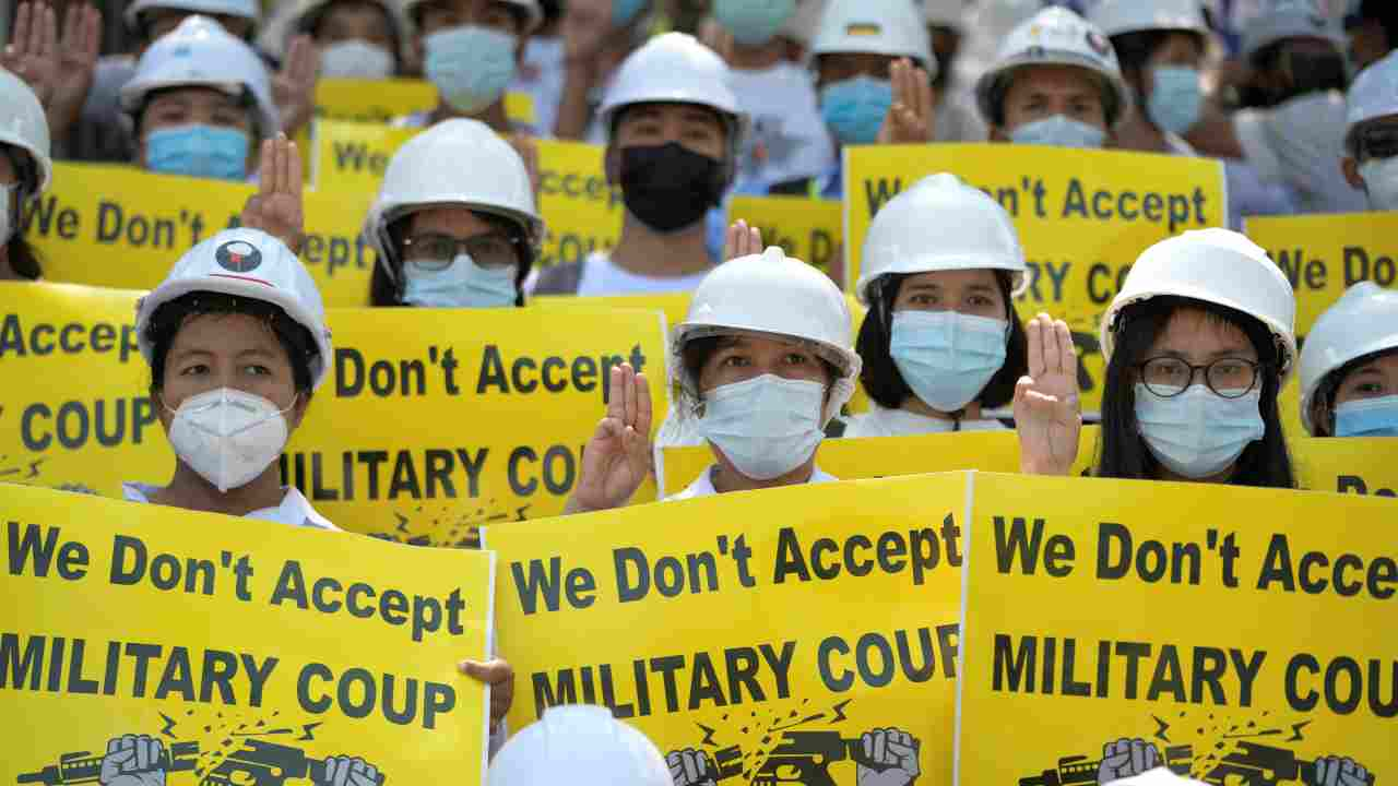 Demonstrators hold placards as they rally against the military coup in Yangon, Myanmar. (Image: Reuters)