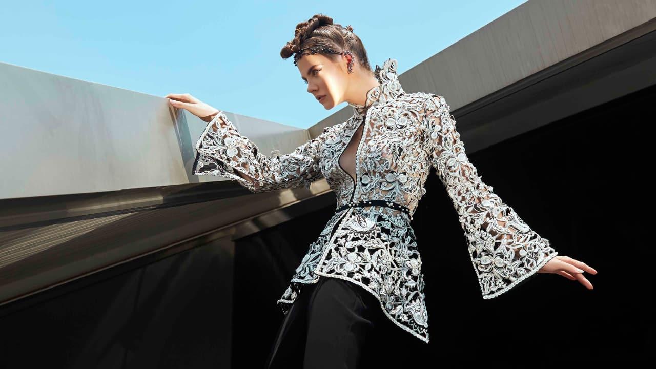 A model posing for Sania Maskatiya's outfit.