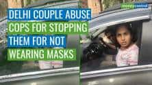 Watch   Delhi couple abuse cops for stopping them for not wearing masks