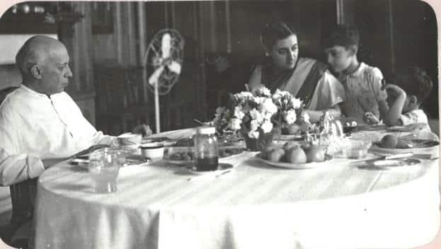 Jawaharlal Nehru with Indira Gandhi and her sons, Rajiv and Sanjay, at Teen Murti House. (via Wikimedia Commons)