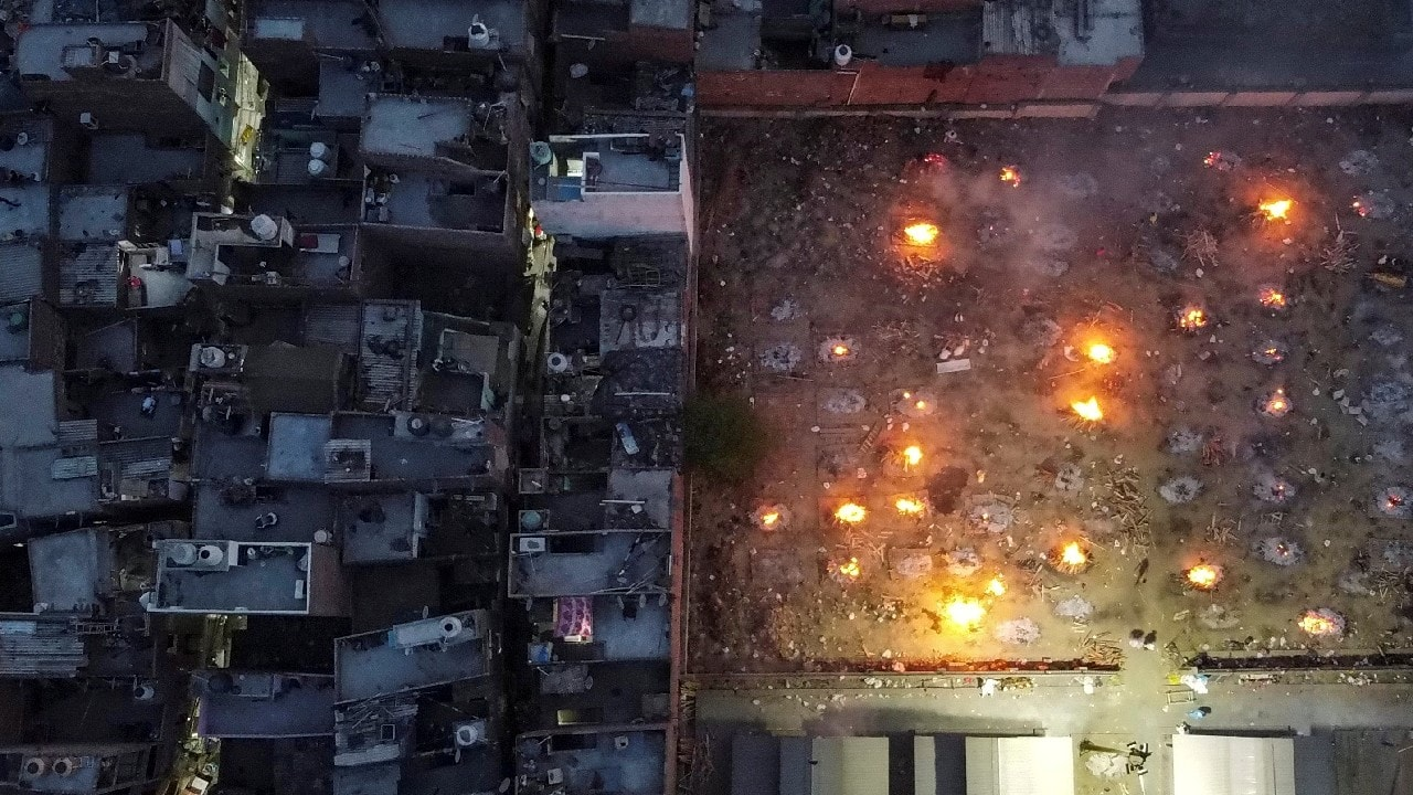 A mass cremation of victims who died due to the coronavirus disease (COVID-19), is seen at a crematorium ground in New Delhi, April 22, 2021. Picture taken with a drone.(Image: Danish Siddiqui/Reuters)