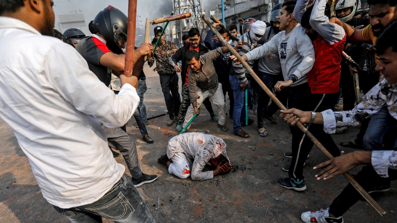 A group of men chanting pro-Hindu slogans, beat Mohammad Zubair, 37, who is Muslim, during protests sparked by a new citizenship law in New Delhi, February 24, 2020. (Image: Danish Siddiqui/Reuters)