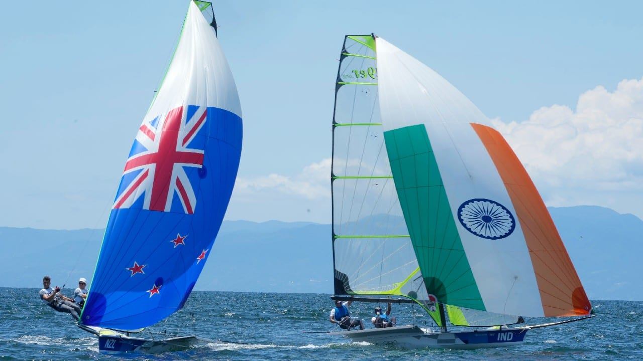 New Zealand, left, and India teams of the men's 49er men class sail in the Enoshima Yacht Harbour during a training session on the occasion of at the 2020 Summer Olympics, July 22, in Fujisawa, Japan. (Image: AP)