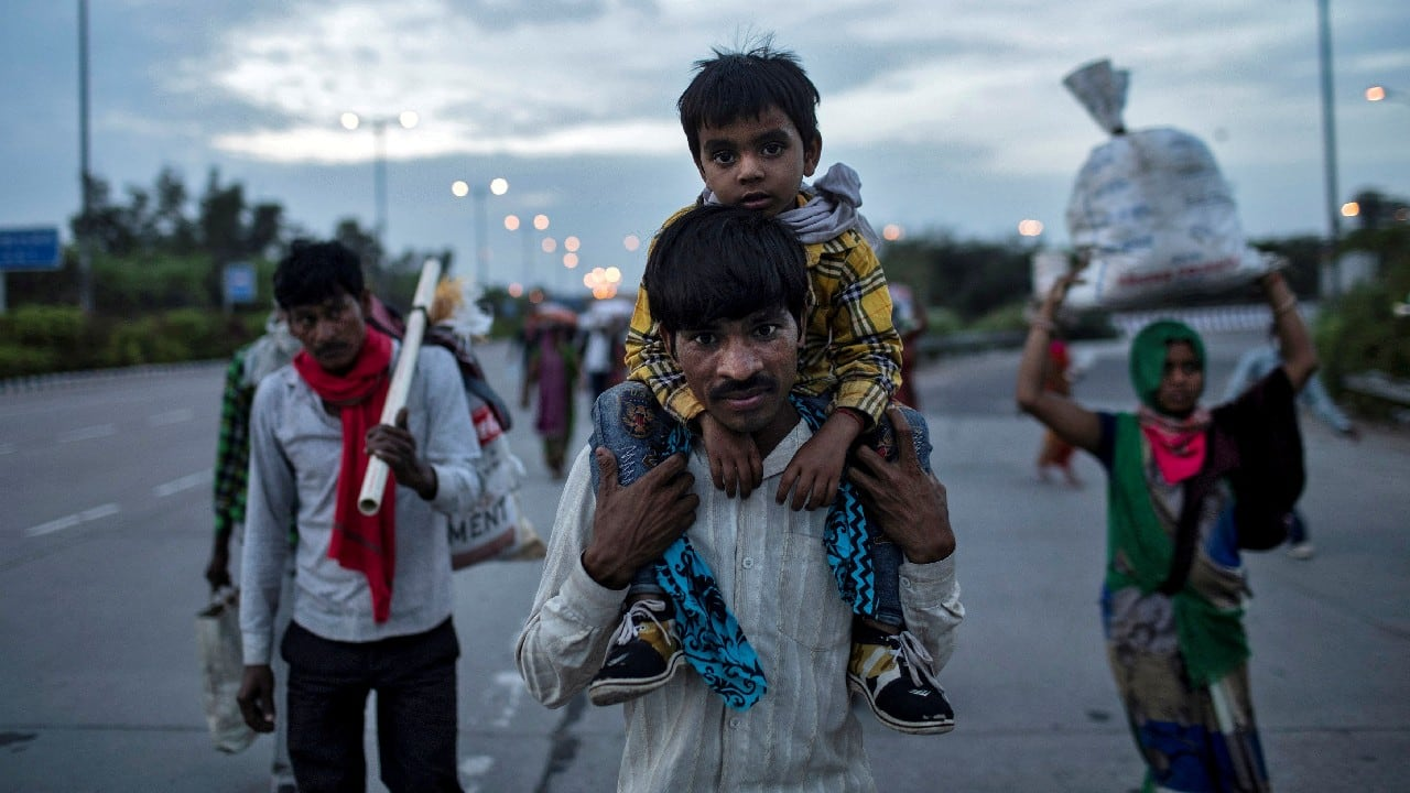Dayaram Kushwaha, a migrant worker, carries his 5-year-old son, Shivam, on his shoulders as they walk along a road to return to their village, during a 21-day nationwide lockdown to limit the spreading of coronavirus, in New Delhi, India, March 26, 2020.