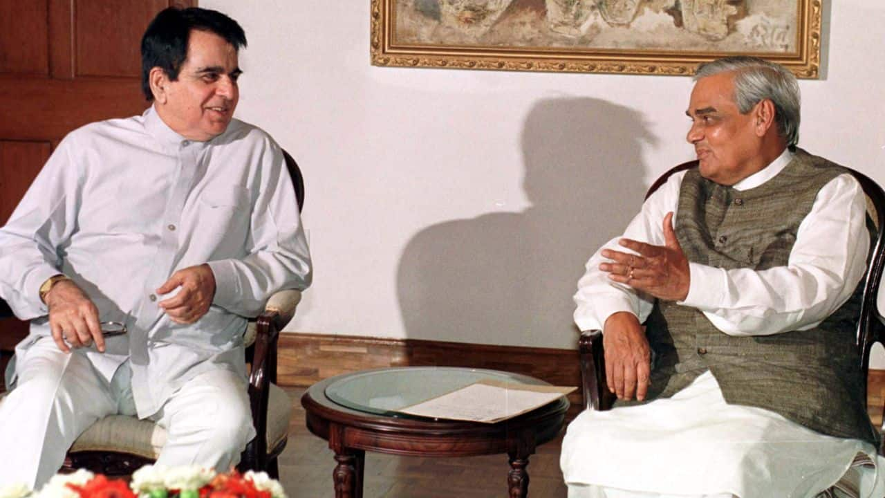 """Indian Prime Minister Atal Behari Vajpayee gestures to Moslem film star Dilip Kumar during a meeting in New Delhi July 11. Kumar called on Vajpayee after right wing Hindu Shiv Sena party asked him to return """"Nishan-E-Imtiaz"""", the highest civilian award by Pakistan, following Kashmir conflict. Vajpayee said it was up to Kumar to return the award and no pressure should be put on him. (Photo: Sunil Malhotra/Reuters)"""