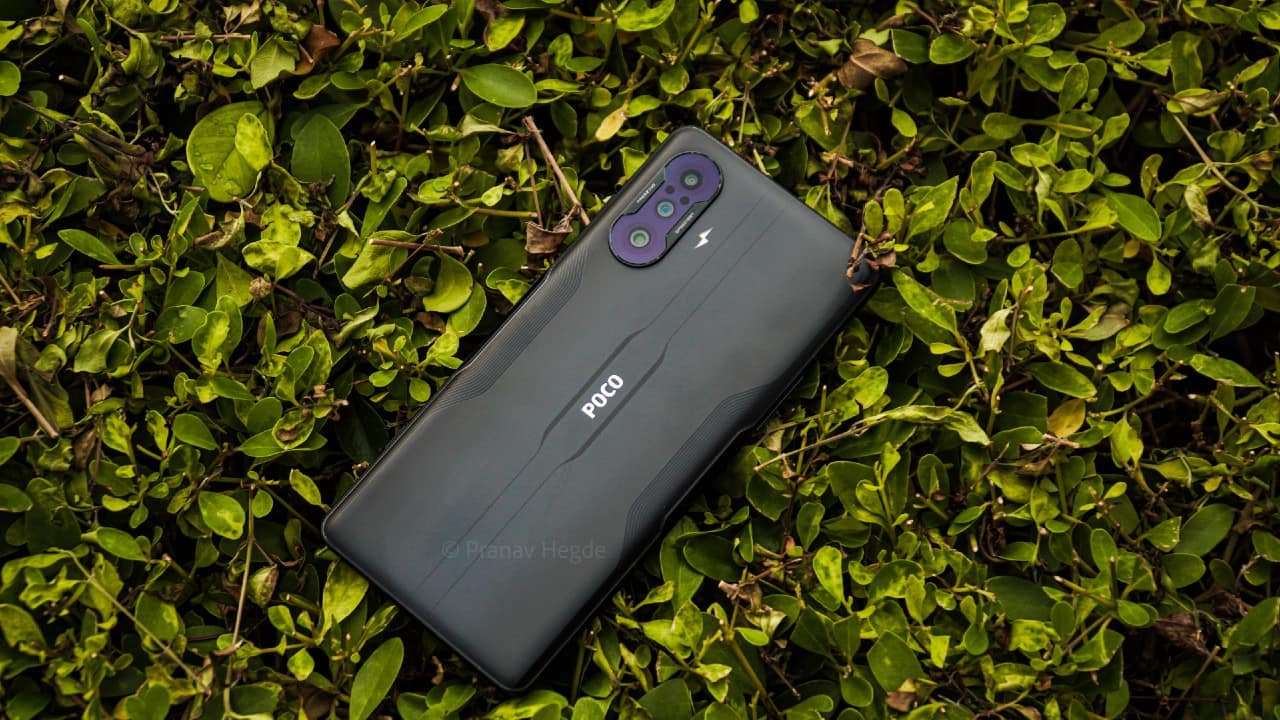 """Poco F3 GT is the answer to the """"When is Poco F2 launching?"""" question asked by many Poco F1 users and other tech enthusiasts. The 2021 Poco flagship in India has evolved into offering an all-around package while taking forward the pro-performance ethos of the Poco F1. It packs a Dimensity 1200 SoC, a 6.67-inch AMOLED 120Hz display, and a 5,065 mAh battery with 67W fast charging support. The smartphone under Rs 30,000 also offers a capable 64MP triple-camera setup and a premium build quality. While the likes of OnePlus Nord 2, Realme X7 Max offer value-for-money hardware, the Poco F3 GT one-ups them with gaming-specific hardware. So, should you consider buying the Poco F3 GT over the OnePlus Nord 2 or any other phone under Rs 30,000 in India? Here is our Poco F3 GT review to help you decide."""